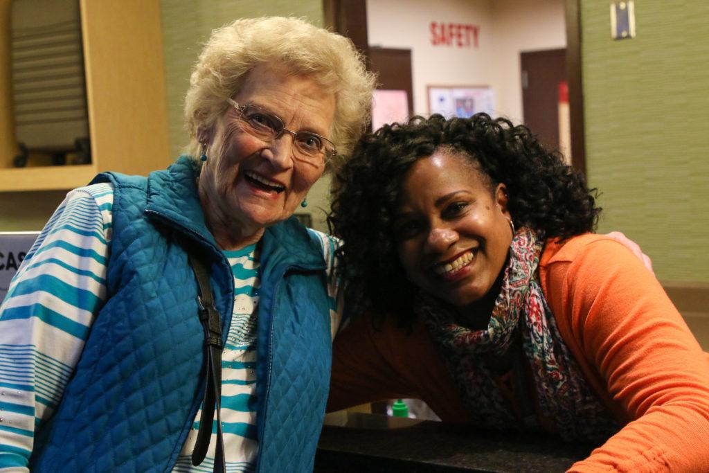 Cynthia Johnson and a customer at the Players Club at Muckleshoot Casino